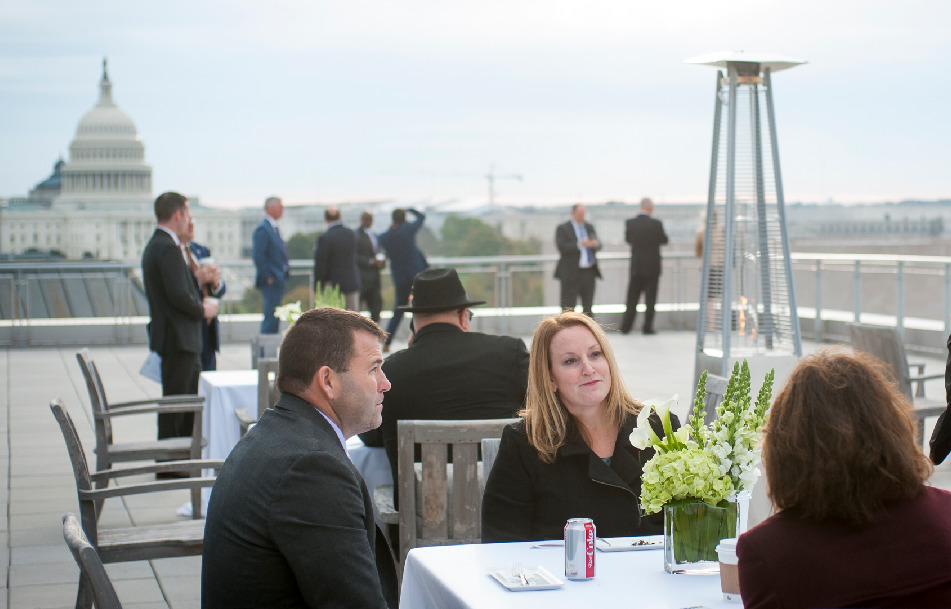 Attendees enjoy the rooftop ambiance.