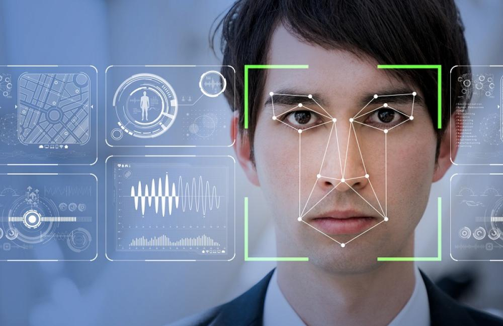 Facial recognition tech laid over a male face
