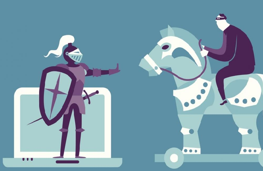 Knight standing on laptop stopping a Trojan horse with rider