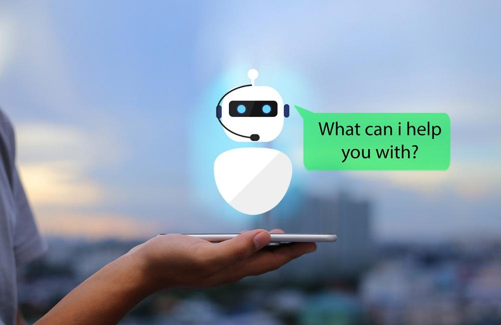 Chatbot standing on top of tablet saying can i help you