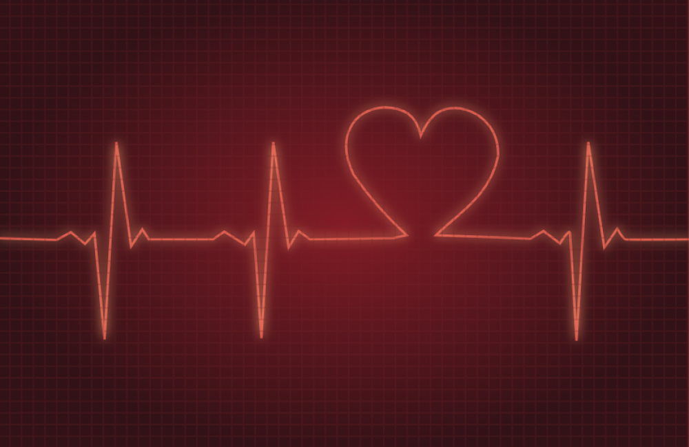 Red heart beat projected onto dark background