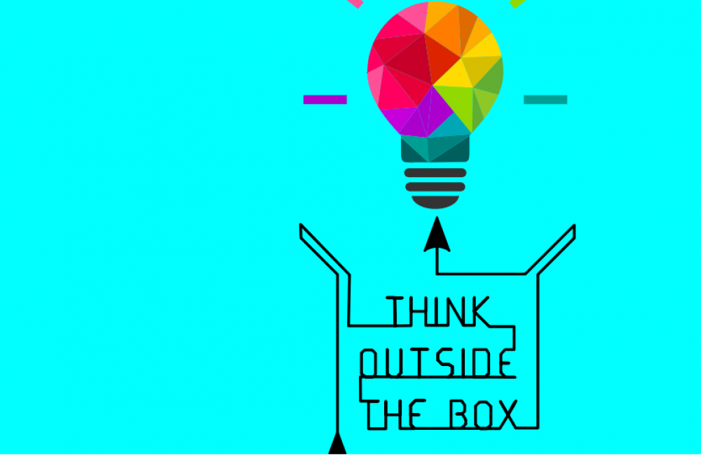 The words 'Think outside the box' pointing towards a multi-colored light bulb