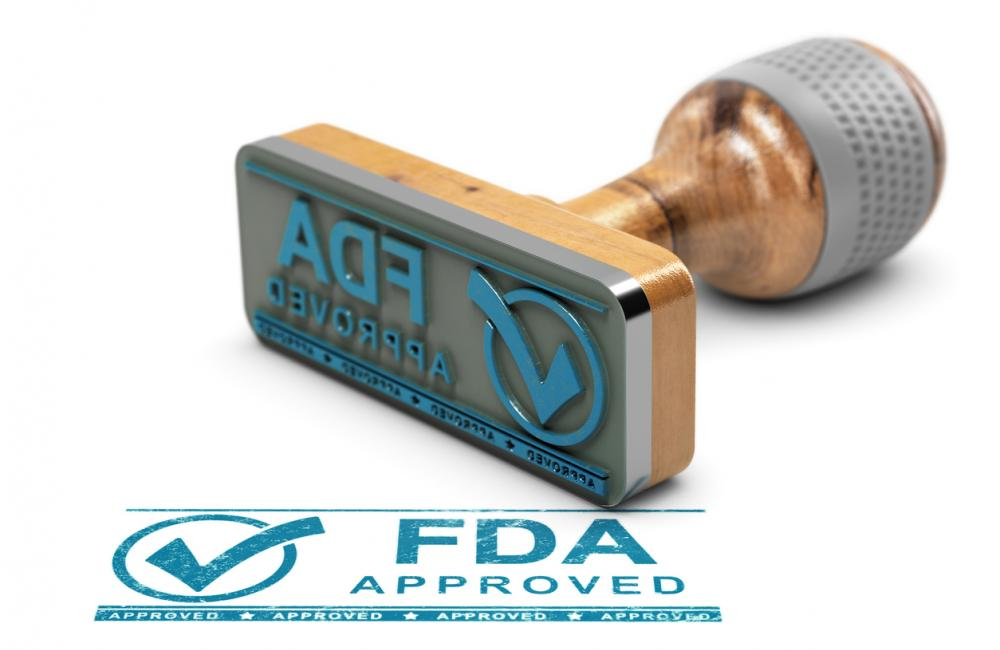 FDA stamp of approval sits on glass table.