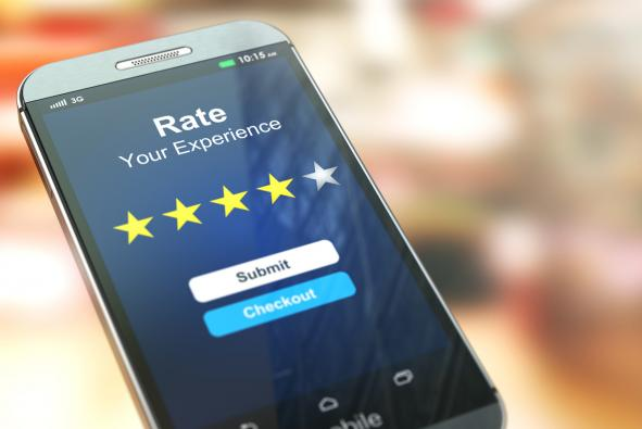 Smartphone or mobile phone with text rate your experience