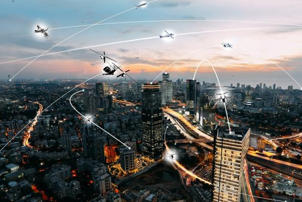 An artist's concept of an Urban Air Mobility environment, with both manned and unmanned air vehicles.