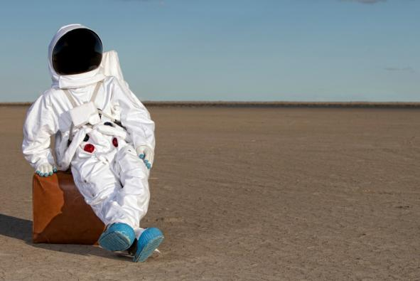 Astronaut lounging in space