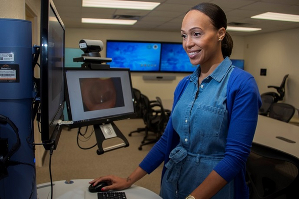 Zekelia Rembert, virtual health nurse care coordinator, reviews patient photos using the virtual health cart at the Virtual Medical Center at Brooke Army Medical Center, Fort Sam Houston, Texas.