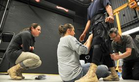 Army researchers evaluate a prototype soft exosuit device developed for the Defense Advanced Research Projects Agency.