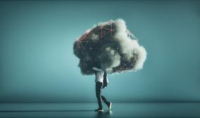 A person carries a visualization of a cloud environment that looks like a real cloud.